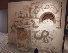 Household lararium in Pompeii. > Photo by Claus Ableiter (2007).