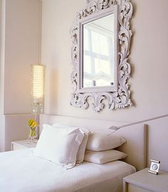 what a lovely guest bedroom this would make - the mirror over the bed is amazing