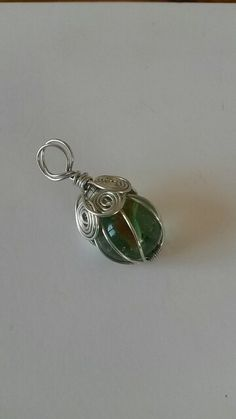 Wire wrapped glass marble