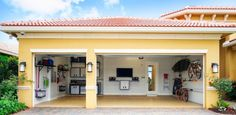 Thinking of a garage makeover? We have nine smart garage design ideas for you. From a home theatre to a game room -- turn your garage into anything 3 Car Garage, Garage Doors, Building A Garage, Shelving Systems, Garage Organization, Garage Storage, Canoe Storage, Garage Shelving, Organization Ideas