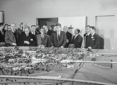 Robert Moses (fourth from right), in his role as president of the New York World's Fair 1964-65 Corp., watches as President John F. Kennedy inspects a model of the fairgrounds.
