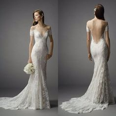 Off the shoulder sleeves, deep v neck, open back, lace dress, and subtle mermaid silhouette
