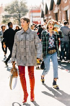 Find out how fashion girls are styling their favorite plaid pieces for We have the street style shots to prove the trend isn't going anywhere. Nyfw Street Style, Street Style Trends, Street Chic, Street Fashion, Street Wear, Milan Fashion, Latest Fashion, Thigh High Boots Outfit, Street Style