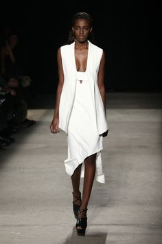 Asymmetrical Hemlines | Narciso Rodriguez Fall/Winter 2015 A classic angled hemline in a crisp white fabric. Perfection. via @stylelist