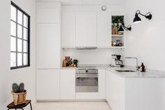 alquimia deco: Una casa de paredes blancas