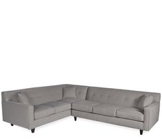 Draper 2-Pc Sectional - This tufted, tight back sofa offers high style with low maintenance. Upholstered in a durable and easy to clean microfiber in putty with down blend
