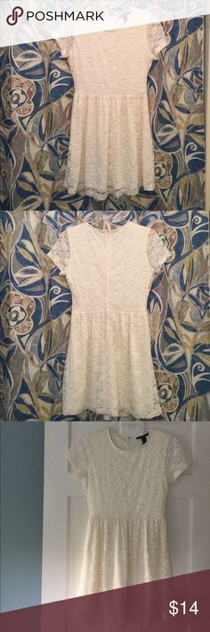 """Forever 21 Cream lace dress Beautiful dress in excellent condition. Fully lined, fit & flare style, scoop neck and cap sleeves.  Bust 16.5"""", length 32"""" from shoulder to hem. Lace is intact, no spots or flaws. Forever 21 Dresses"""