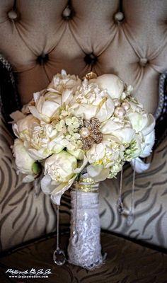 Bridal bouquet, i really like the broach.