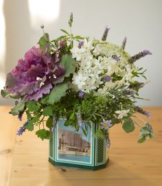 tea tin flower arrangement