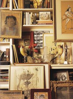Diana Vreeland's bookshelves. Her portrait by Cecil Beaton is behind the polished horn.
