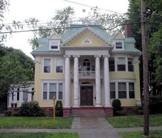 The impressive Colonial Revival house at 893 Clinton Avenue in Bridgeport was built in 1903 for Albert S. Wells, general superintendent of the Bridgeport Malleable Iron Company. In 2010, Bridgeport's Zoning Board of Appeals rejected a proposal to establish a group home for homeless women veterans in the Wells House. Local residents had been fighting to preserve the residential character of their neighborhood.