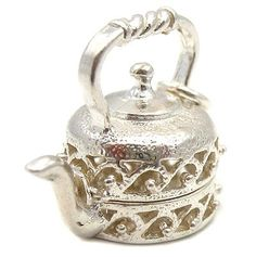 Welded Bliss Sterling 925 Silver Kettle Opening Hinged Charm Showing Tea Pot, Cup And Saucer. WBC1121 Welded Bliss http://www.amazon.com/dp/B003VAC202/ref=cm_sw_r_pi_dp_S7W6wb0P0J5A0