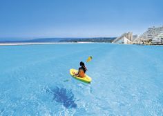 Worlds Largest pool. The Crystal Lagoon, located at the San Alfonso del Mar resort in Algarrobo, Chile, is the world's largest outdoor pool, stretching more than half of a mile and filled with 66 million gallons of water. Oh The Places You'll Go, Places To Travel, Places To Visit, Dream Vacations, Vacation Spots, Piscina Do Hotel, Ideas De Piscina, Big Pools, Viajes