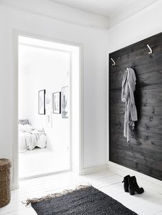 Swedish apartment, white with black accents and a little hint of brass, brown & green to warm it up / http://dustjacket-attic.com