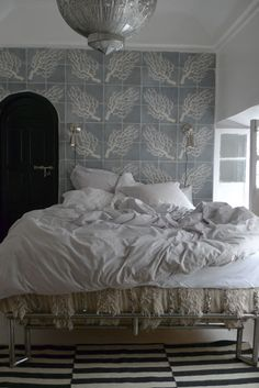 Need this bedroom...or at least a Moroccan wedding blanket as a bed skirt.