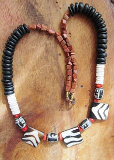 Items similar to Attractive African style necklace, Zebra pattern on carved horn beads, ostrich shell, wood and gold stone beads on Etsy African Style, African Fashion, Handmade Jewelry, Unique Jewelry, Handmade Gifts, Selling Jewelry, Fashion Necklace, Trending Outfits, Bracelets