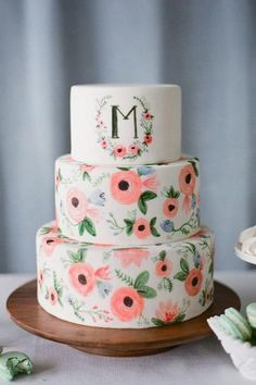 Monogramed Masterpiece - Watercolor Wedding Cakes Might Be the Next Big Wedding Trend - Southernliving. Light and lively, this watercolor wedding cake has a whole lot of personality.  Click here to see the pin.