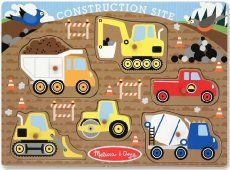 Looking for a fun indoor activity? Try this easy toddler activity and make a construction site sensory bin! Your toddler will love this simple sensory bin.