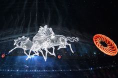 A picture taken on February 7, 2014 shows horse shaped light displays during the Opening Ceremony of the Sochi Winter Olympics at the Fisht ...