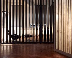 Screens made from wooden slats adding both privacy and transparancy. The Touch Digital by Post-Office.