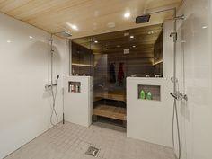 A modern bathroom with a sauna. / Pesuhuoneessa sijaitsee tunnelmallinen sauna. www.valaistusblogi.fi