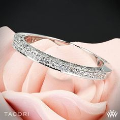This beautiful creation is pictured with round pave-set diamonds halfway around the ring. Tacori Classic Crescent Pave Half Eternity Diamond Wedding Ring
