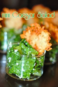 Mini Caesar Salads. The link appears to be broken to this site; however, just toss a caesar salad together, put in cute little cups, add a parmesan cheese wafer and ta da! Instant appetizer to WOW your guests.