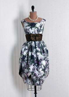 Cocktail Dress: 1950's watercolor floral taffeta print, heavily-ruched satin bow-tie cummerbund bodice, sculpted Origami petals bubble skirt design.