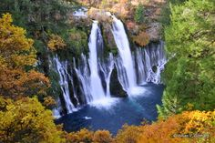 The beautiful McArthur-Burney falls surrounded by a mantle of autumn foliage
