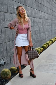 Kier Mellour in forever 21 white denim mini skirt and mauve duster with Louis Vuitton Brittany bag in Magnolia and Charles David leopard and dark brown wedges