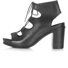 TOPSHOP NATTER Ghillie Footbed Heeled Sandals ($110) ❤ liked on Polyvore featuring shoes, sandals, topshop, black, genuine leather shoes, black block heel sandals, cutout sandals, black leather shoes and topshop sandals