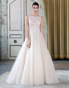 This gorgeous gown was purchased in 2015 for my wedding in 2016. When it came in, there wasn't enough time to alter it before my wedding, and so it has never been worn. It is ivory with crystal and pe