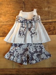 The Sorella Girls Peasant shirt with Ruffle knee shorts, Capris, or Pants with fabric sash detail. Mod grey and white damask fabric. Perfect