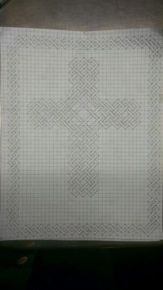 Celtic knot cross on graph paper