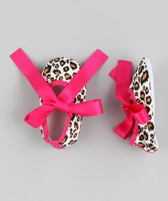 I don't have any girls in my family... YET! I need a niece to spoil! Baby's personality is a little sassy and a lot sweet—here is a pair of shoes to match. These fashionable flats feature a bold animal print that little toes are sure to go wild for. t. 100% cottonHand wash / line dryImported