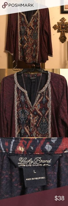 Lucky Brand Tribe Top Tunic Blouse Sz L😍💐 Lucky Brand Tribe Top Tunic Blouse Sz L😍💐 Very beautiful size large I do not know what it's made of I am the second owner and it looks like they cut off part of the tag tell you the material. But it is very stretchy and soft I think whoever like that would feel very comfortable lightweight. Great for summer. The colors are burgundy red with blue and white. Comes from a non-smoking home I ship Monday Wednesday Friday. Do you have any questions…