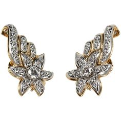 Tiffany & Co. Schlumberger shooting star earrings. 3.60 carats of total diamonds set in 18 karat yellow gold and platinum, circa 1960