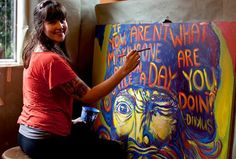 """All of you will remember Sara Snedeker, she painted the 6' x 6' gorgeous beyond beautiful 'Just Say Hello' sign for our building!  Well Amazing Artist Sara is at it again for our HinS community; she's painting a 4' x 4' sign of friend Dinkus McGank and his life life philosophy written over top of his cap, it says, """"If you aren't making one person smile a day, what are you doin?""""  A bigBIG HinS hug for Sara from ALL of us in the HinS community!!!  Fremont 1/10/2013 Just Say Hello, Hello Sign, Heart Projects, Life Philosophy, Seattle, In This Moment, University, Events, Artists"""
