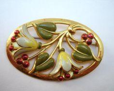 1940s enamel white flower brooch from https://www.etsy.com/listing/197513377/enamel-flower-oval-frame-brooch?ref=favs_view_8