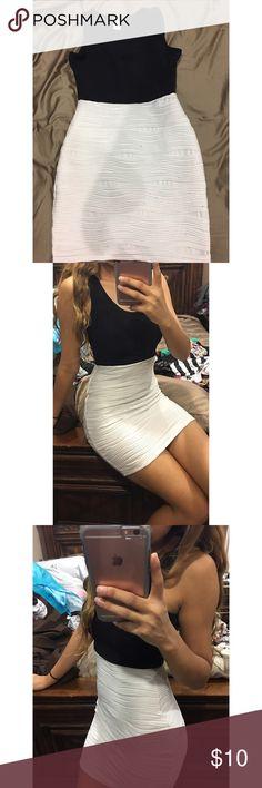 Form fitting dress Black and white, tank top like dress. Very form fitting, tight little dress. Dresses Mini