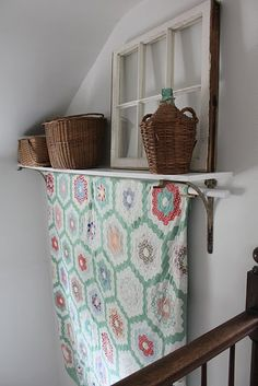 quilt display...great DIY way to create a quilt rack with a shelf!