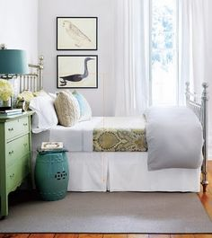 peaceful - note the light gray wall color that the white-based drawings pop off of, the analogously colored greens and green-blues, and the neutral warm patters on the spread, all contained neatly in white (curtains, sheets, bedskirt) and gray (quilt, rug)