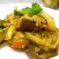 """Baingan Bharta (Eggplant Curry) By: Yakuta """"This is a really easy and tasty Indian dish that is sure to stir up your taste buds. Delicious baingan bharta is ready to eat with pita bread, Indian naan, or rice. Curry Recipes, Veggie Recipes, Indian Food Recipes, Vegetarian Recipes, Cooking Recipes, Healthy Recipes, Naan, Curry D'aubergine, Curry Food"""