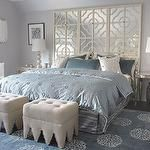 bedrooms - blue gray walls ivory mirrored quatrefoil pattern floor screen headboard mirrored tables nightstands champagne metal lamps light gray linen tufted ottomans silver garden stools Madeline Weinrib Atelier Light Blue Mandala Rug