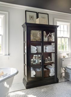 Cabinets help tell the story of our home and lives. Here are tips for filling th… Cabinets help tell the story of our home and lives. Here are tips for filling these statement pieces with head-turning displays. Bathroom Cabinets, Bathroom Storage, Small Bathroom, Bathroom Vanities, Bathroom Ideas, Bathroom Cleaning, White Bathroom, Wooden Furniture, Linen Cabinet In Bathroom