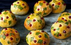 Brioche Rolls with Parsley and Pomegranate  - These moist, golden brown rolls will steal the spotlight on your dinner table and a topping of parsley and pomegranate makes them even more celebratory.