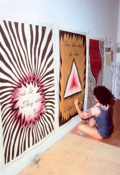 "Judy Chicago designing the entry banners for ""The Dinner Party,"" 1978. Photo courtesy of Through the Flower Archive."