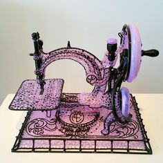 """""""Raphine"""" by Micah Evans.Functional sculpted glass pipe. It's a 1887 Wilcox and Gibbs chain-switch sewing machine."""