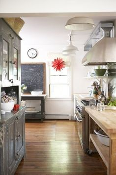 modern & vintage kitchen - i love the bright red at the back!