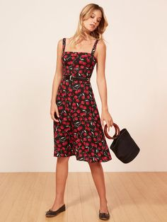 3f398c0371c This is a midi length dress with non-functional center front buttons